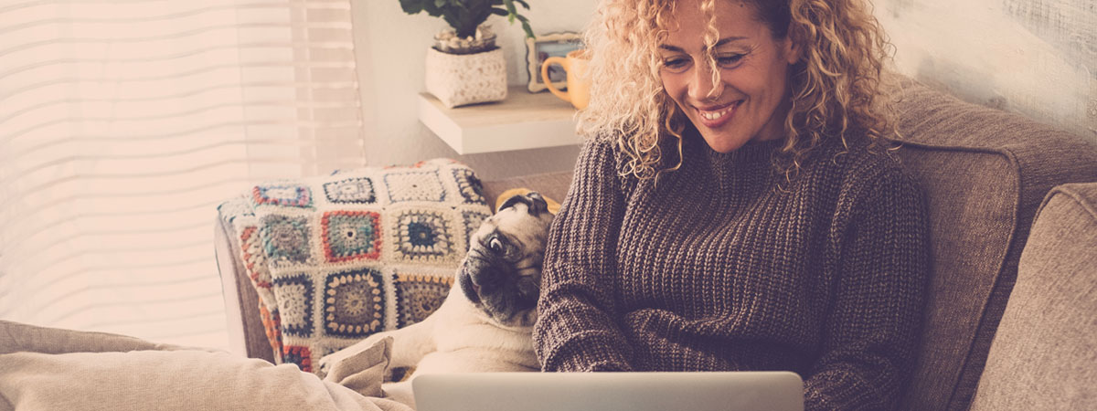 woman with laptop and dog